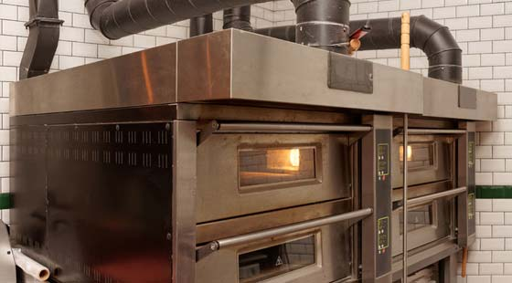 Johnson Gas - gas appliance repairs page image of commercial oven.